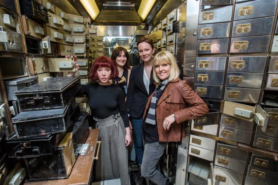 The cast of Blue Moon Over Poplar among the Hatton Garden safety deposit boxes