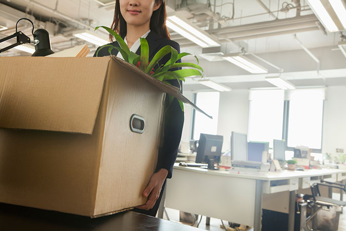 An employee lends a hand at moving office