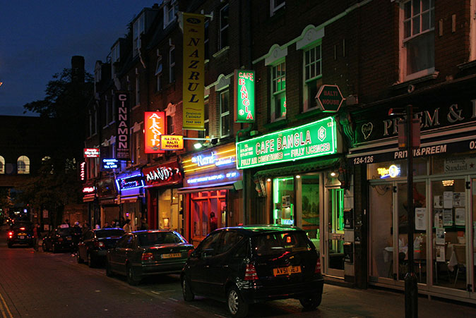 "A line of ""curry house"" restaurants in Brick Lane"
